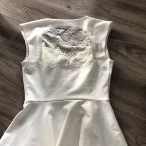Guess Tops - Guess brand peplum top in ivory